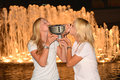 Us open women doubles champions ekaterina makarova and elena vesnina posing with us open trophy new york september at billie jean Royalty Free Stock Image