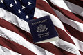 US Passport and American Flag Royalty Free Stock Photo