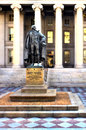 Us treasury in washington dc with statue of founder symbolizing wealth Stock Image