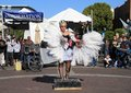 Usa az street artist swan and bed of nails a member the circus school arizona csa attempts the trick in a costume she dances to Stock Images
