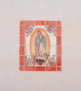 Usa az tucson our lady of guadalupe mosaic this decorates the wall san xavier del bac near it closely resembles the original icon Stock Photo