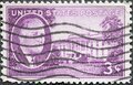 USA - Circa 1945: a postage stamp printed in the US showing a portrait by Franklin Roosevelt Stamps. Background: White House Royalty Free Stock Photo