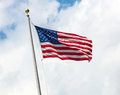 USA flag on blue sky with clouds Royalty Free Stock Photo