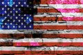 USA flag on a brick wall background with broken plaster Royalty Free Stock Photo
