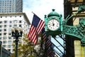 Usa flag images shows a clock with flags on a street in chicago il Stock Photo