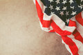 USA flag over vintage paper with copy space. 4th of july background Royalty Free Stock Photo