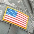 USA flag patch on solders uniform - close up studio shot