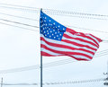 USA flag waving with a cloudy sky Royalty Free Stock Photo