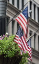 USA flags waving in the streets Royalty Free Stock Photo