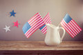 USA independence day celebration. USA flags in jug on wooden table