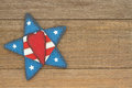 USA patriotic old flag on a star and weathered wood background Royalty Free Stock Photo