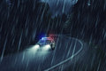 USA police car at work at night in the forest, heavy rain, motio Royalty Free Stock Photo
