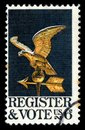 USA Postage Stamp Register and Vote with an eagle weathervane