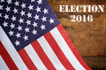 Usa presidential election flag with american stars and stripes on wood background with added text Stock Images