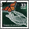 USA - 2000: shows Hand and butterfly, computer generated art, series Celebrate the Century, 1990s Royalty Free Stock Photo