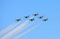 Usaf thunderbirds in formation six f fighter jets flying a wedge while trailing smoke as part of the aerial demonstration during Stock Images