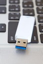 Usb flash drive on a computer notebook Royalty Free Stock Photography