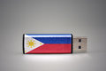 Usb flash drive with the national flag of philippines on gray background. Royalty Free Stock Photo