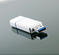 Usb flash drive with reflection on glossy background black Royalty Free Stock Image