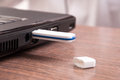 USB flash drive stick connected to laptop Royalty Free Stock Photo