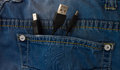 Usb plug in a jeans pocket dark blue with Royalty Free Stock Photography