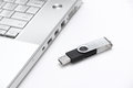 USB thumb drive and a laptop Royalty Free Stock Photo