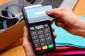 Use payment terminal and credit card with nfc technology for paying for purchases in store contactless reader clothes Royalty Free Stock Images