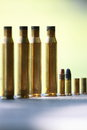 Used ammo spent rounds lined up on concrete table at an outdoor shooting range Stock Photography