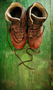 Used boots on old green wooden floor Stock Photo