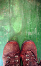 Used boots on old wooden floor Stock Images
