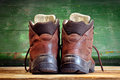 Used boots on old wooden floor Stock Image