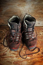 Used boots on old wooden floor Stock Photo