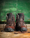 Used boots on old wooden floor Stock Photography