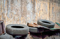 Used car tires with old cracked paint wall Royalty Free Stock Photo