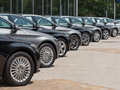 Used cars for sale in a long row Stock Image