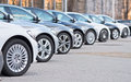 Used cars for sale in a long row Stock Photos