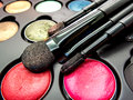 Used cosmetic cushion eye shadow eye liner brusher lip highl multi color highlight shading selective focus Royalty Free Stock Photos