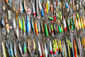 Used fishing lures on old wooden fence Stock Photo