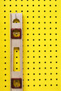 Used level hanging on pegboard Royalty Free Stock Photos