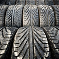 Used old car tires detail pattern background or texture junk Royalty Free Stock Photography