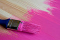 Used paintbrush on half painted pine board dirty wooden surface Stock Image