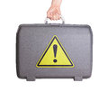 Used plastic suitcase with stains and scratches danger exclamation mark Stock Images