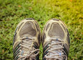 Used sport shoes on yard background Royalty Free Stock Photo
