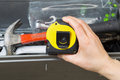 Used tape measure horizontal photo of female hand taking out of toolbox Royalty Free Stock Photo