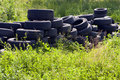Used tires thrown in nature. Stock Photo