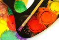 Used water color paint box and paint brush closeup of messy Stock Photography