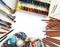 Used water color paint box paint brush pencils and pastels on white wooden background with copy space Stock Image