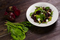 Useful vegetable salad with beet walnuts and mozzarella Royalty Free Stock Image