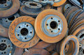 Useless old rusty brake discs worn out Royalty Free Stock Photography
