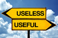 Useless or useful opposite signs two opposite road signs against blue sky background Royalty Free Stock Image